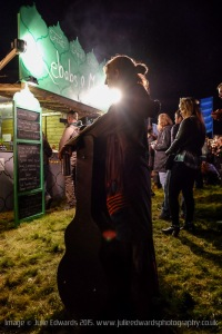 Atmosphere at Festival No.6 on 04/09/2015 at Portmeirion, Gwynedd, North Wales. A musician waits in a food queue at night.