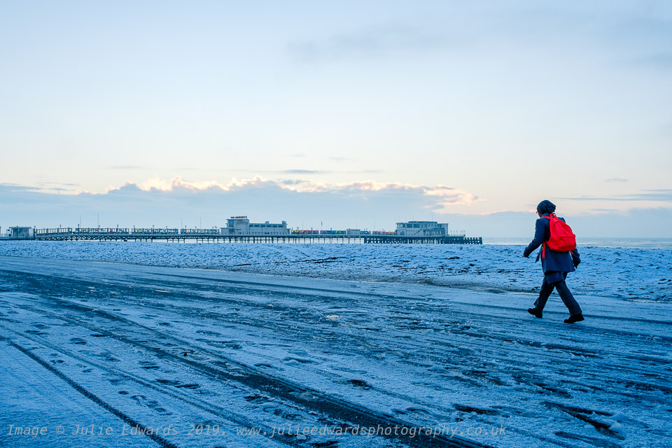 Commuters walk along the icy promenade as Snow hits the South East of the UK on Friday 1 February 2019